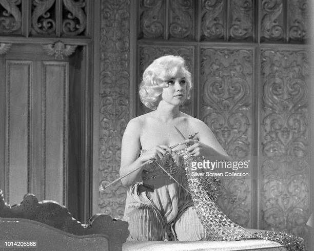 American actress Marilyn Monroe films a scene for the musical comedy 'Let's Make Love' 1960
