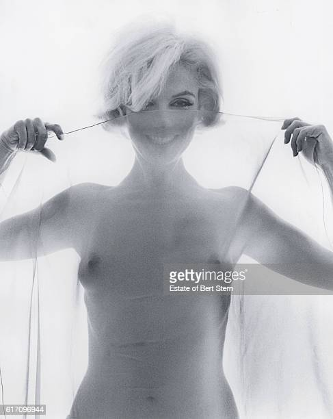 American actress Marilyn Monroe holding a sheer scarf Beverly Hills California June 1962 The two sessions for the photoshoot took place in late June...
