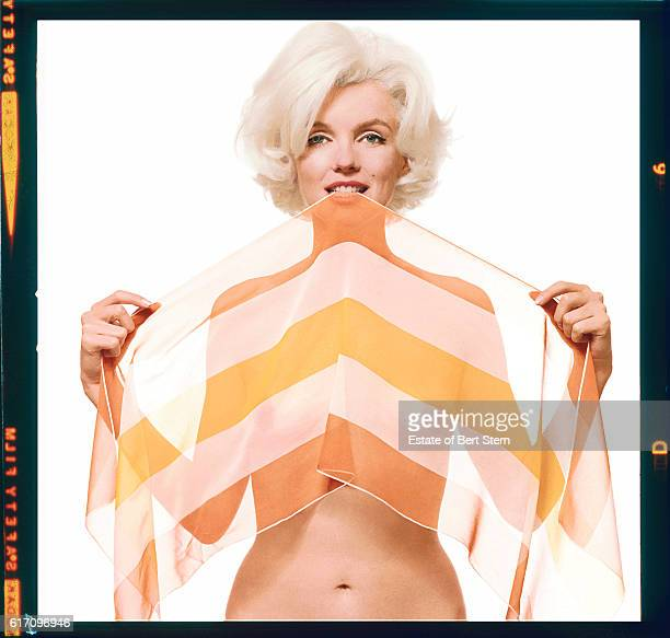 American actress Marilyn Monroe holding a striped Vera Neumann scarf in her teeth Beverly Hills California June 1962 The two sessions for the...