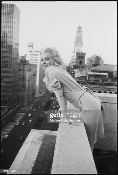 American actress Marilyn Monroe leans over the balcony of the Ambassador Hotel in March 1955 in New York City, New York.