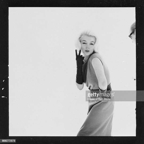American actress Marilyn Monroe (1926 - 1962) making a peace sign, Beverly Hills, California, July 1962. The two sessions for the photoshoot took place in late June and early July, only weeks before her death on 5th August 1962. The images were published posthumously in Vogue magazine under the title 'The Last Sitting'.
