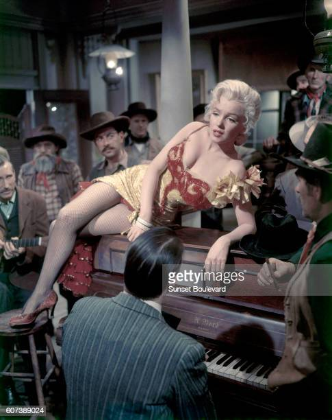 American actress Marilyn Monroe on the set of River of No Return directed by Austro–HungarianAmerican Otto Preminger