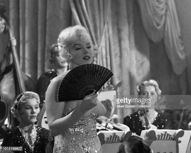 American actress Marilyn Monroe performs a musical number in a scene from the comedy 'Some Like It Hot', 1959.