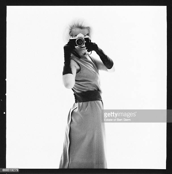 American actress Marilyn Monroe pointing a Nikon camera at photographer Bert Stern Beverly Hills California July 1962 The two sessions for the...