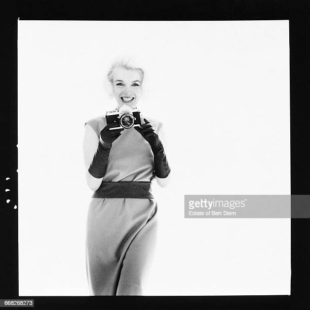 American actress Marilyn Monroe pointing a Nikon camera at the photographer Beverly Hills California July 1962 The two sessions for the photoshoot...