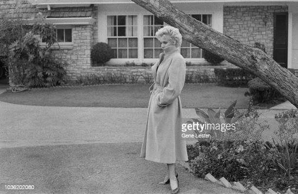 American actress Marilyn Monroe poses outside her home during a photo call California USA 1956