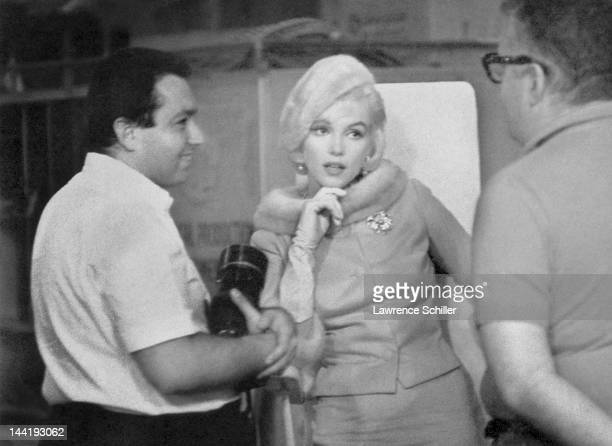 American actress Marilyn Monroe poses with photographers Lawrence Schiller and William Read Woodfield on the set her film 'Something's Got to Give'...