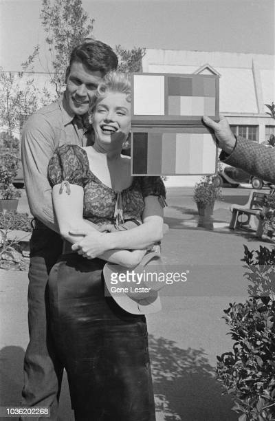 American actress Marilyn Monroe preparing to pose with costar Don Murray during a press call to publicise Joshua Logan's 'Bus Stop' 1956