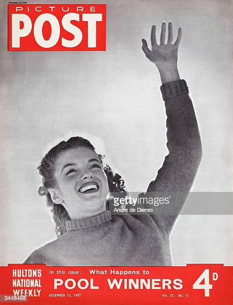 American actress Marilyn Monroe raises her hand on the cover of Picture Post magazine, December 1947. The headline beneath reads 'What Happens to...