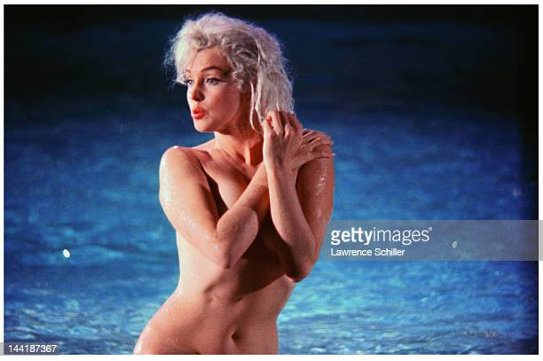 APPLY American actress Marilyn Monroe topless stands in a pool during the filming of 'Something's Got to Give' Los Angeles California May 23 1962