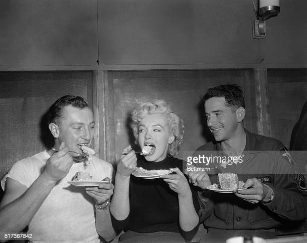 American actress Marilyn Monroe tries some cake in the Enlisted Men's Mess Hall at Headquarters Company 2nd Infantry Division near Seoul South Korea...