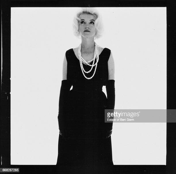 American actress Marilyn Monroe waering a black dress and pearls Beverly Hills California July 1962 The two sessions for the photoshoot took place in...