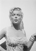 American actress marilyn monroe wearing a beaded gown on the set of picture id1036713166?s=170x170