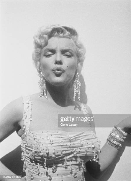 American actress Marilyn Monroe wearing a beaded gown on the set of 'There's No Business Like Show Business' directed by Walter Lang at the 20th...