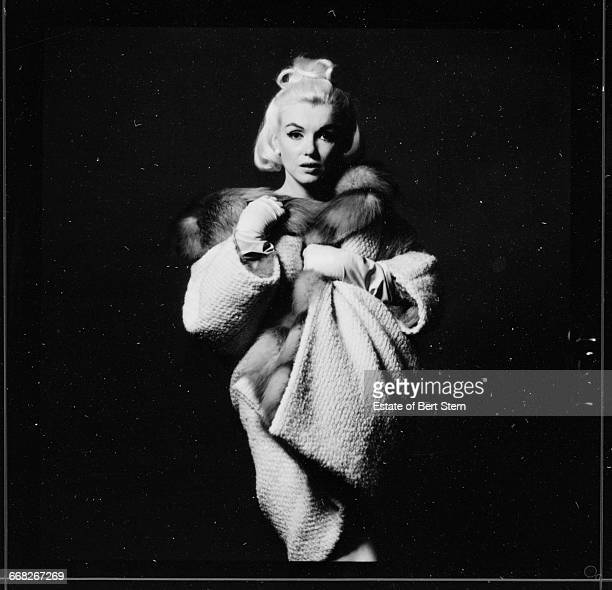 American actress Marilyn Monroe wearing a furlined white coat Beverly Hills California July 1962 The two sessions for the photoshoot took place in...
