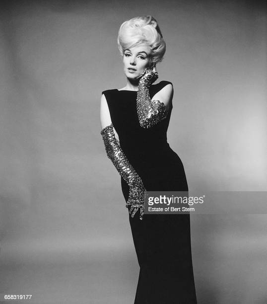 American actress Marilyn Monroe wearing a sleeveless dress and evening gloves Beverly Hills California July 1962 The two sessions for the photoshoot...