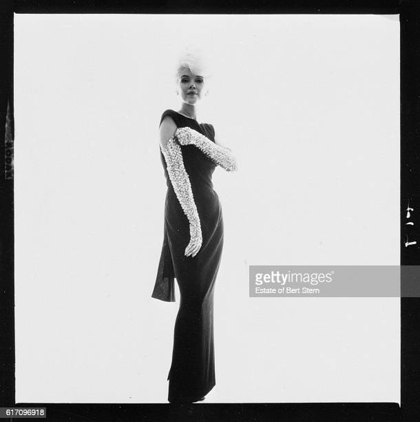 American actress Marilyn Monroe wearing a sleeveless dress and silver evening gloves Beverly Hills California July 1962 The two sessions for the...