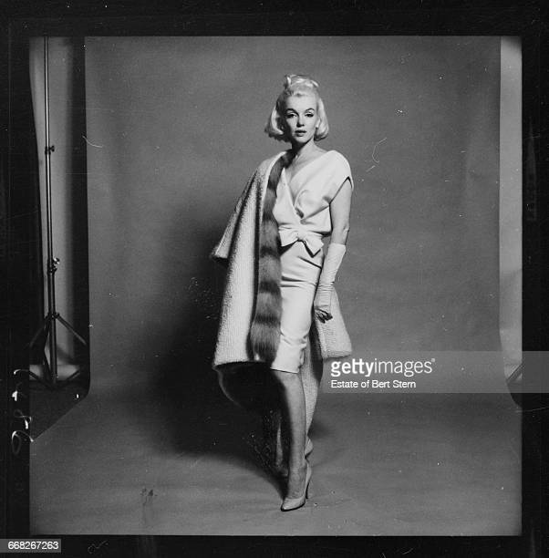 American actress Marilyn Monroe wearing a white dress and a furlined white coat Beverly Hills California July 1962 The two sessions for the...