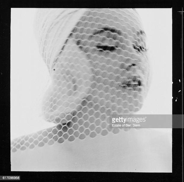 American actress Marilyn Monroe wearing a white hat and veil Beverly Hills California July 1962 The two sessions for the photoshoot took place in...