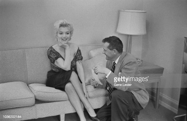 American actress Marilyn Monroe with a reporter during a press call to publicise her latest film Joshua Logan's 'Bus Stop' 1956