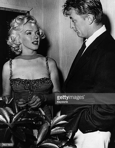 American actress Marilyn Monroe with actor Robert Mitchum at a Hollywood party Original Publication People Disc HW0715