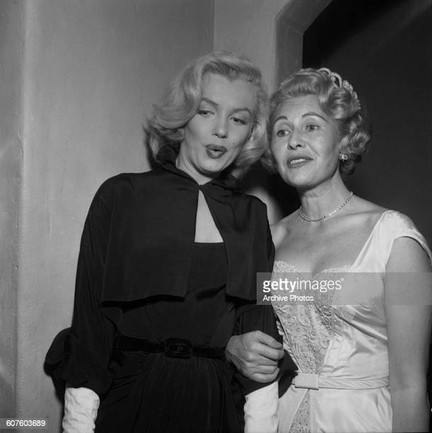 American actress Marilyn Monroe with Englishborn Hollywood gossip columnist Sheilah Graham at Graham's wedding reception 14th February 1953 The...