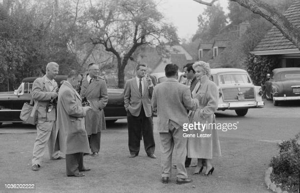 American actress Marilyn Monroe with photographers and reporters outside her home during a photo call California USA 1956