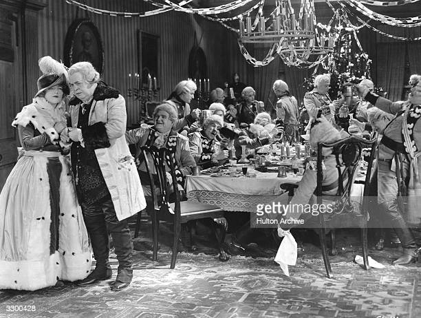 American actress Marion Davies is being consoled by a gentleman while a drunken party goes on in the background A scene from 'Janice Meredith'...