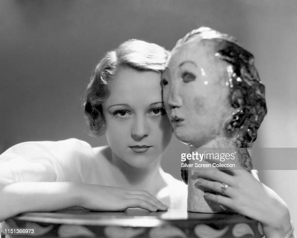 American actress Marion Davies poses with a ceramic head circa 1925