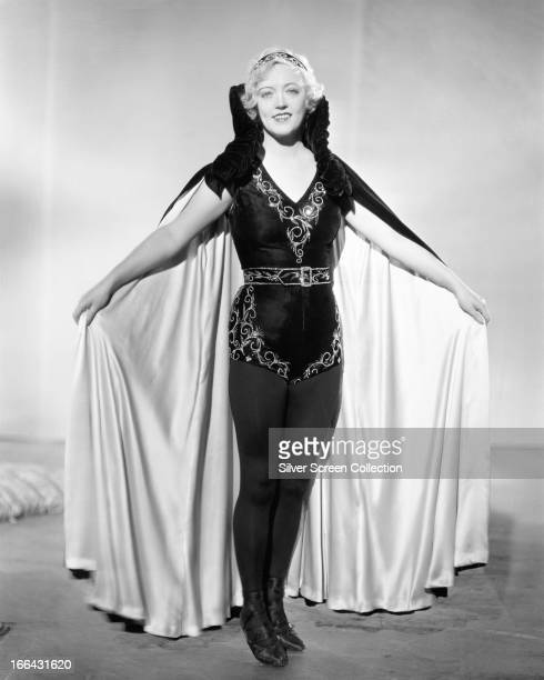 American actress Marion Davies wearing an embroidered leotard and a cape circa 1925