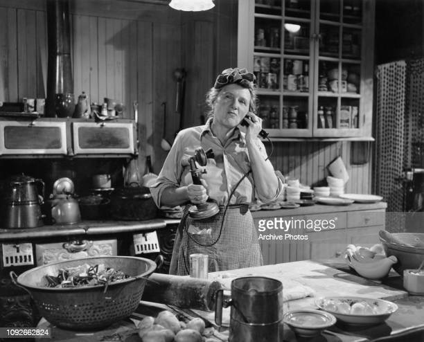 American actress Marjorie Main wins a radio 'name that tune' contest in a scene from the film 'Mrs O'Malley and Mr Malone' 1950