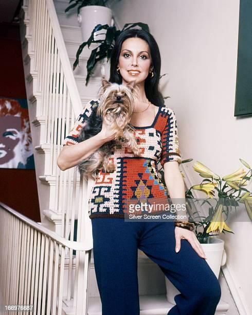 American actress Marlo Thomas holding a Yorkshire terrier circa 1970