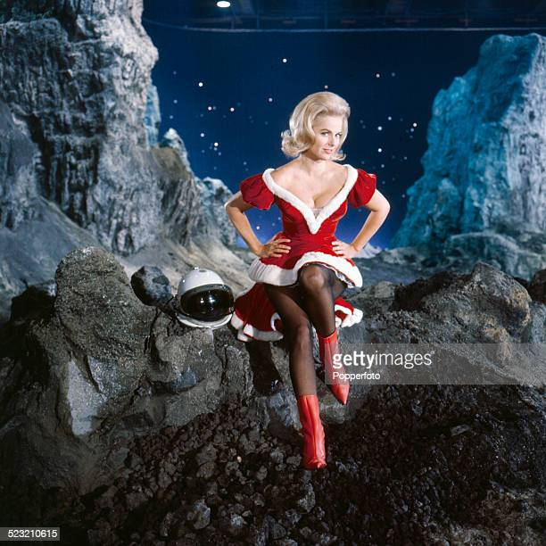 American actress Martha Hyer posed in a red and white short dress on the set of the film 'The First Men In The Moon' in 1963