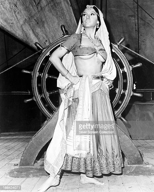 American actress Mary Ann Mobley wearing a harem outfit on the deck of a ship circa 1970