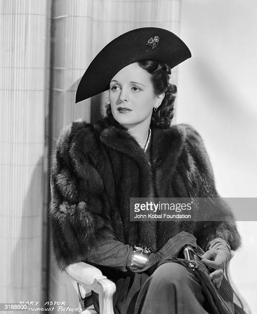 American actress Mary Astor wearing a fur coat hat and gloves