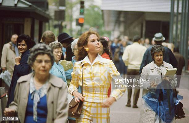 American actress Mary Tyler Moore , as Mary Richards, walks down a crowded city street for the CBS situation comedy 'Mary Tyler Moore,' Minneapolis,...