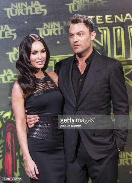 American actress Megan Fox and her husband Brian Austin Green pose for the German premiere of 'Teenage Mutant Ninja Turtles' in Berlin Germany 05...