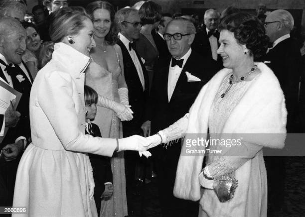 American actress Meryl Streep meeting Queen Elizabeth II after a Royal Film Performance of 'Kramer vs Kramer' at the Odeon Leicester Square London...
