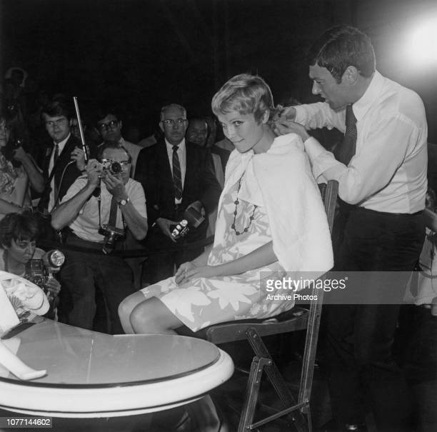American actress Mia Farrow has her hair cut short by stylist Vidal Sassoon, at Stage 13 of the Paramount Studios in Hollywood, California, 14th...