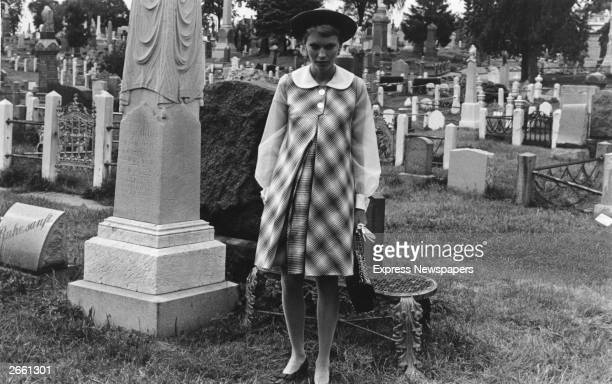 American actress Mia Farrow in a graveyard during filming of 'Rosemary's Baby'.