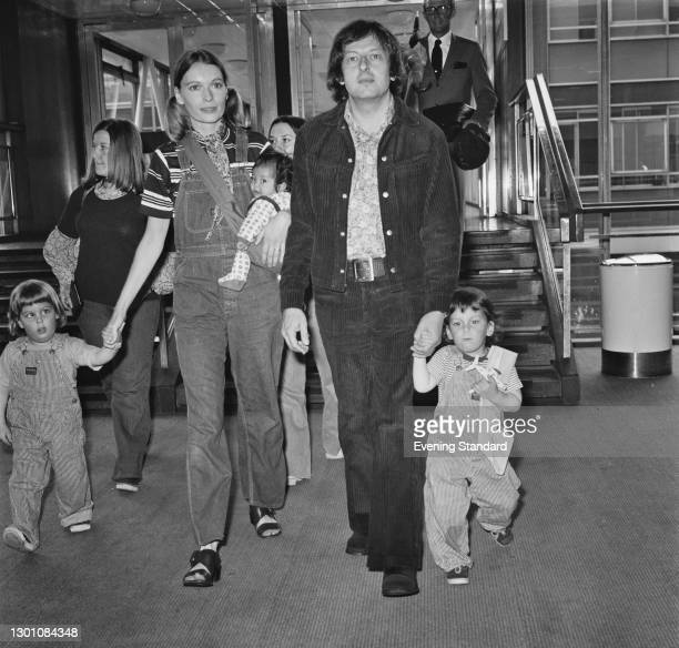 American actress Mia Farrow with her husband, conductor and composer André Previn and their children at Heathrow Airport in London, UK, en route to...