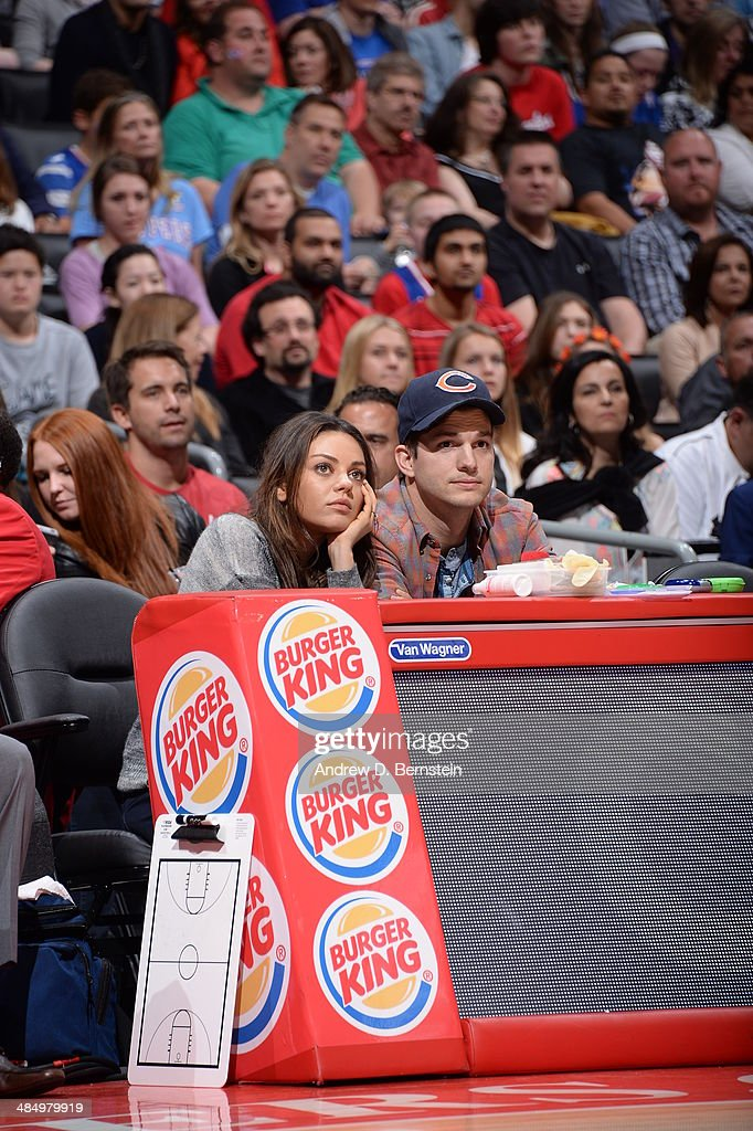 American Actress Mila Kunis and American Actor Ashton Kutcher take in a game at STAPLES Center on March 22, 2014 in Los Angeles, California where the Los Angeles Clippers took on the Detroit Pistons.