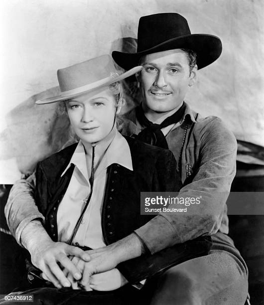 American actress Miriam Hopkins and Australian actor Errol Flynn on the set of Virginia City directed by Michael Curtiz