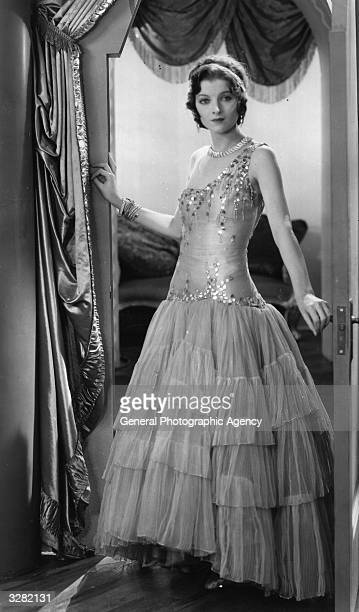 American actress Myrna Loy born Myrna Williams wearing a sequined gown in a scene from the film 'Hardboiled Rose' Title Hardboiled Rose Studio Warner...