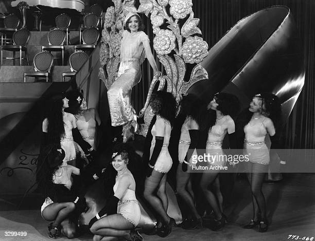 American actress Nancy Carroll surrounded by chorus girls in a scene from the starstudded musical revue 'Paramount On Parade' The host of directors...
