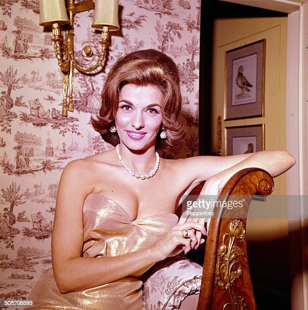 American actress Nancy Kovack posed sitting on a chaise longue at the Dorchester Hotel in London in 1965