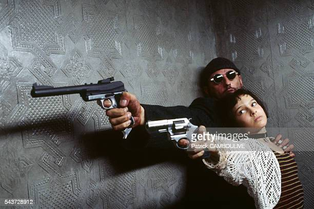 American actress Natalie Portman and French actor Jean Reno on the set of the film 'Leon' directed by Luc Besson