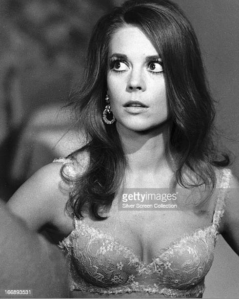 American actress Natalie Wood wearing a lacy bra in a promotional portrait for 'Bob Carol Ted Alice' directed by Paul Mazursky 1969