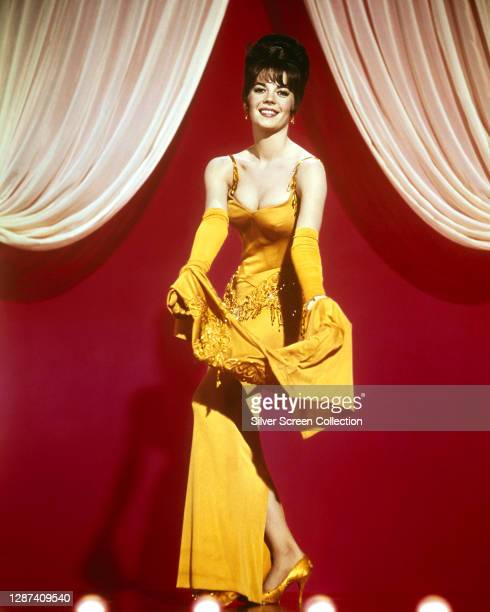 American actress Natalie Wood wearing a yellow evening dress in her role as Gypsy Rose Lee in the film 'Gypsy', 1962.