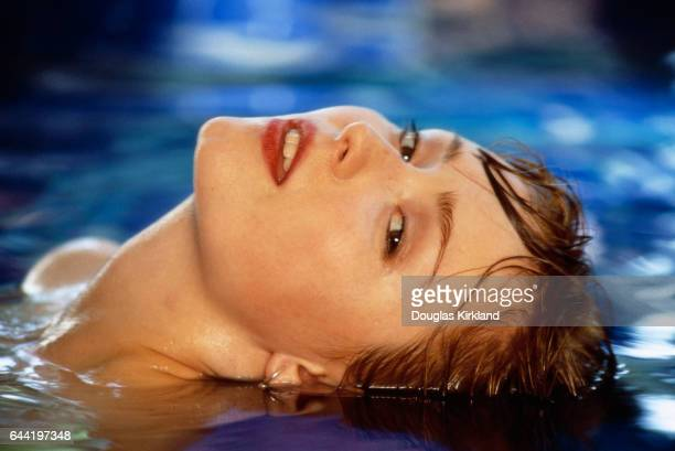 American actress Nina Siemaszko leans her head back in a pool during the filming of the 1992 motion picture Wild Orchid II Two Shades of Blue The...